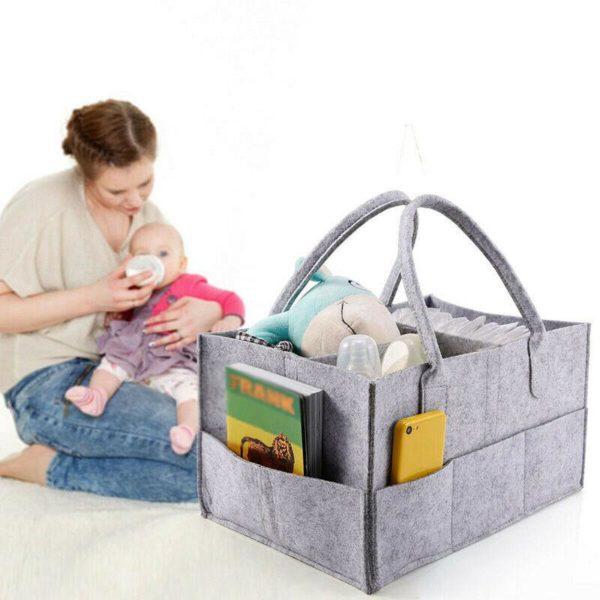Praktický přenosný pořadač pro miminko