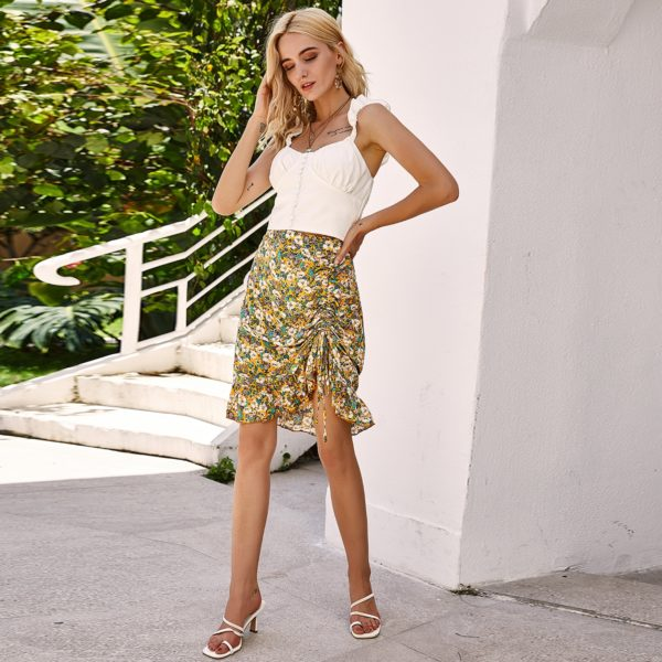 Dámská elegantní květinová letní sukně s vykasaným rozparkem