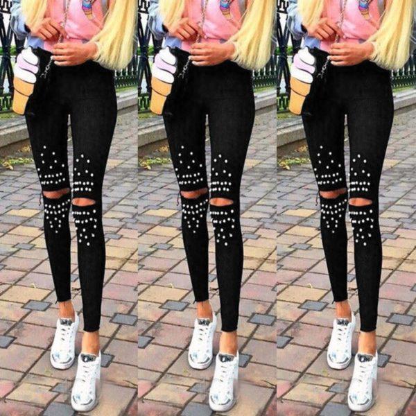 Černé dámské džíny s cvoky s dírami na kolenou
